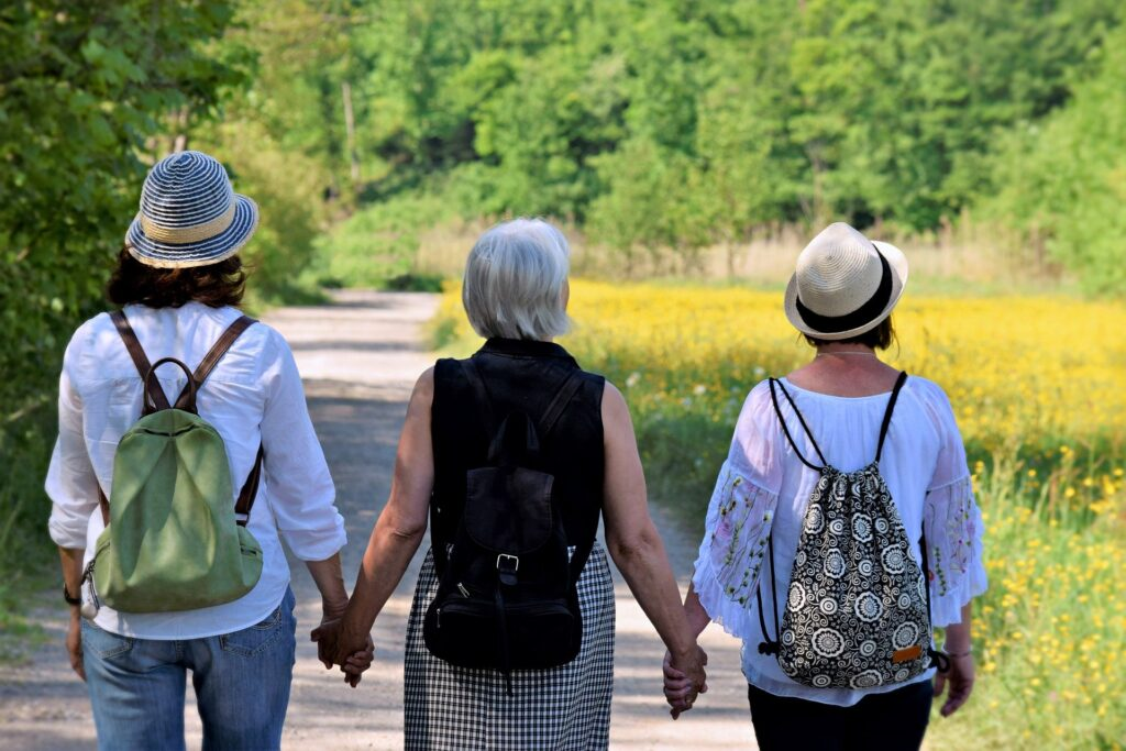 Three elderly women holding hands - Menopause featured image